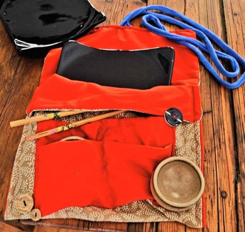 Red and brown fabric sushi set bag