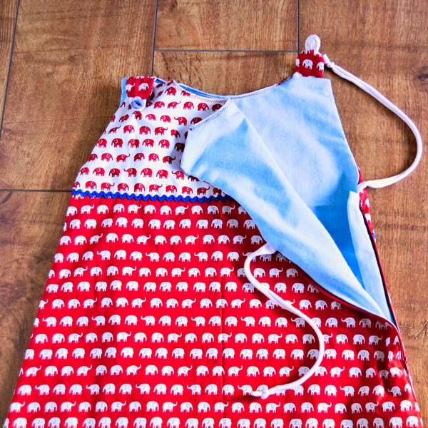 Red baby sleeping bag with elephants pattern