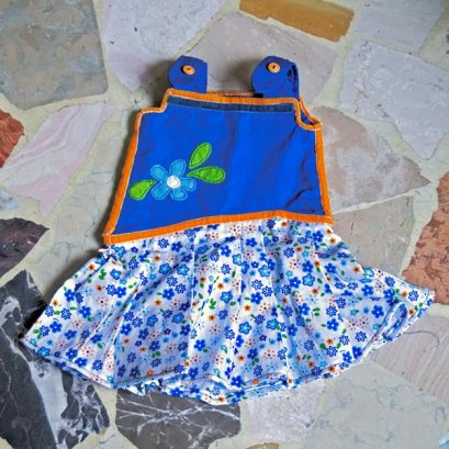Blue and orange summer baby dress with flower pattern