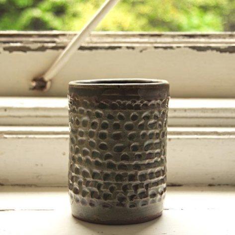 Green ceramic vase with dot pattern