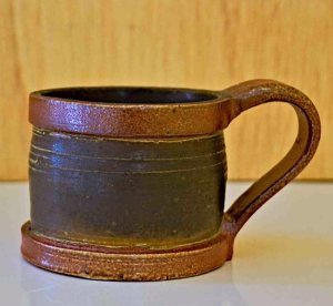 Brown and black ceramic cup