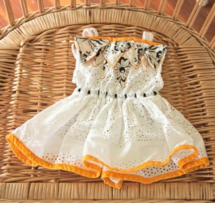 White and orange summer baby dress with floral pattern