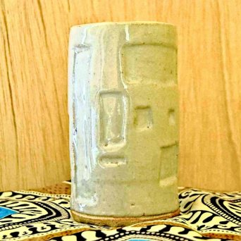 White ceramic vase with engravings