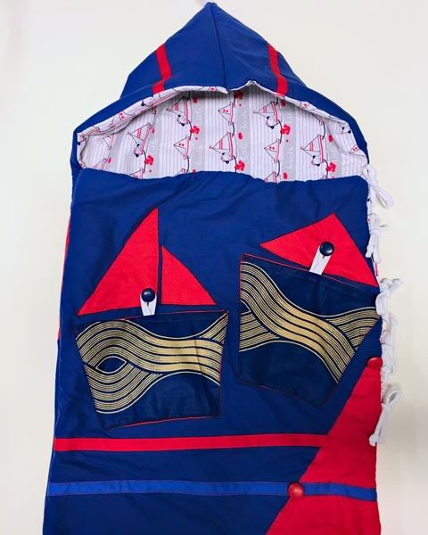 Blue and red baby sleeping bag with sailing motives