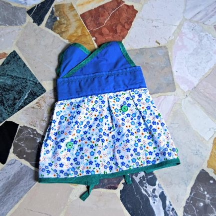 Blue and green summer baby dress with flower pattern