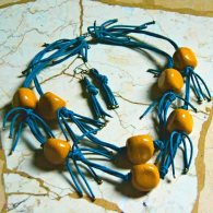 Blue strings and yellow beads necklace