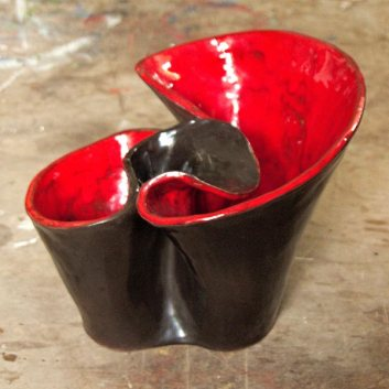 Black and red terracotta and commercial glazes ceramic wavy vase