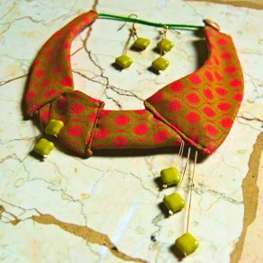 Orange Shwe-Shwe fabric with green clay beads necklace and matching earrings