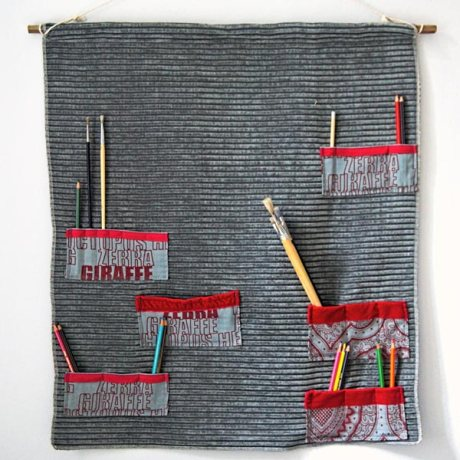 Grey fabric with red pockets wall organizer