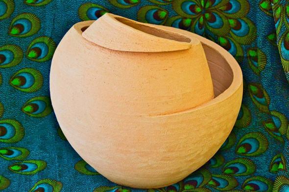 Grogged terracotta spiral ceramic vase with raw finishing