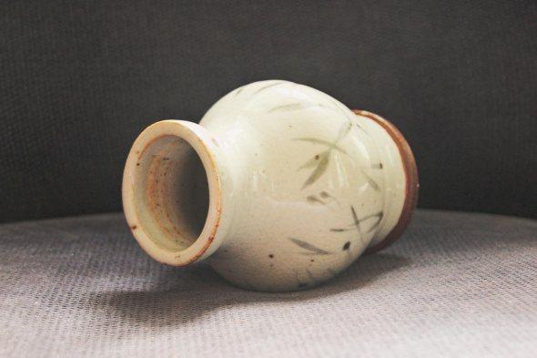 White asian style terracotta vase