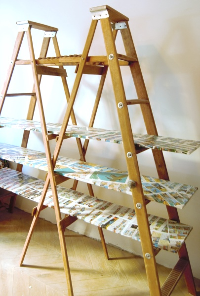 Bookshelf made with ladders and comics
